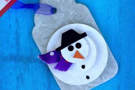 chiudipacco di Natale a forma di pupazzo dii neve