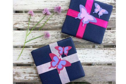 pacchetti regalo con farfalle fatte a mano